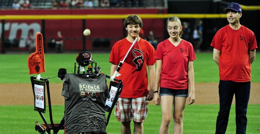 Bruce The Pitching Robot Throws Out The First Pitch As Students Who Built The Machine From Paradise Valley High School Watch During The Game Between The Arizona Diamondbacks And The Washington Nationals At Chase Field. Photo By Matt Kartozian-USA TODAY Sports