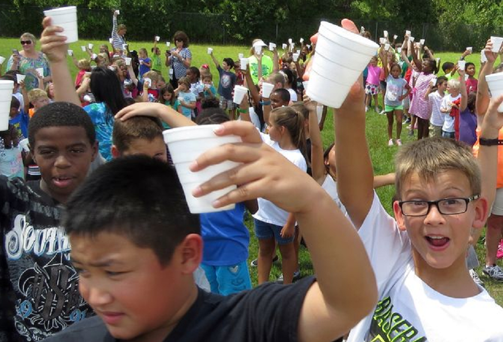 Students At Blue Angels Elementary Prepare To Pour Cups Of Ice Over Their Heads As They Accept The ALS Bucket Challenge Friday Afternoon At Their School. (Photo: Bruce Graner/bgraner@pnj.com Bruce Graner/bgraner@pnj.com)