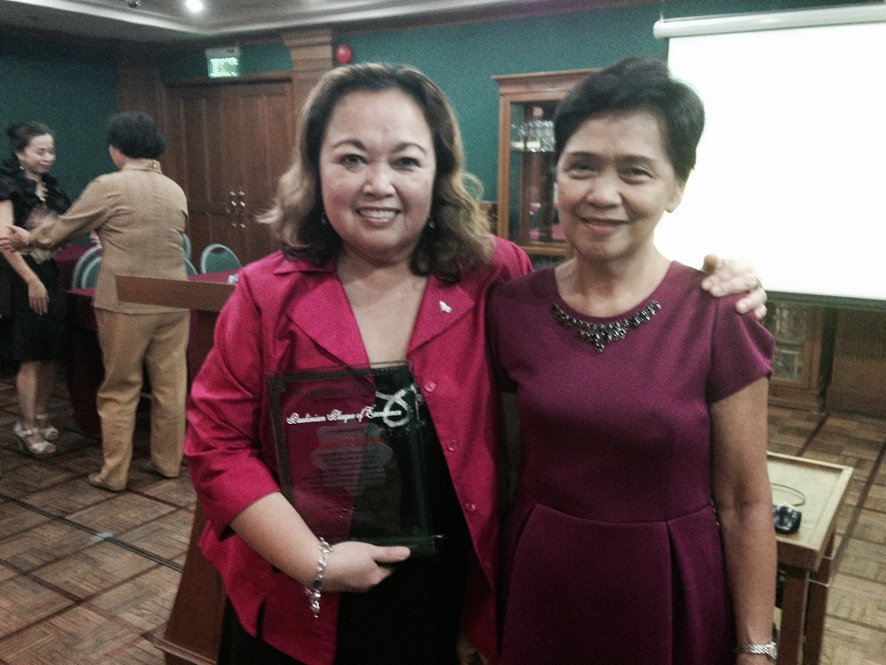 "Connolly Middle School Special Education Teacher Annette Asuncion, Left, Received The ""Paulinian Plaque Of Excellence"" From St. Paul University Manila In Manila, Philippines For Her Volunteer Work And Assistance In Opening The Music Therapy Program.  Asuncion Stands Proudly With The First Music Therapy Masters Program Graduate. Photo Courtesy Tempe Elementary School District"