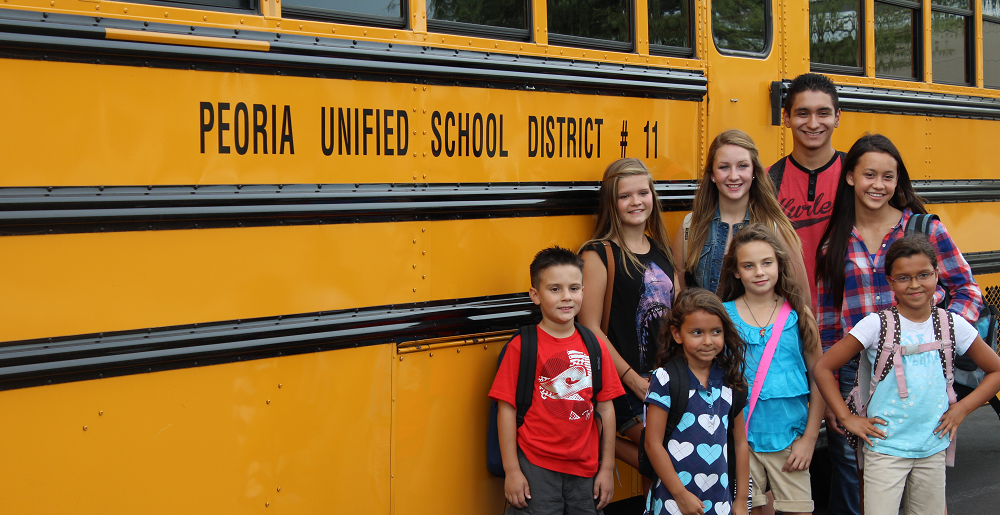 Peoria Unified School District Students Stand Beside A Bus. Photo Courtesy Peoria Unified School District