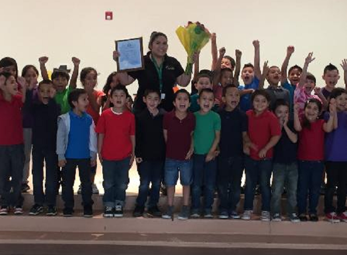 Tapia named English Language Learner Teacher of the Year RaquelTapiaAndStudents