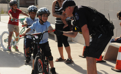 Scales Technology Academy first-graders receive gift of first bikes ScalesBikes