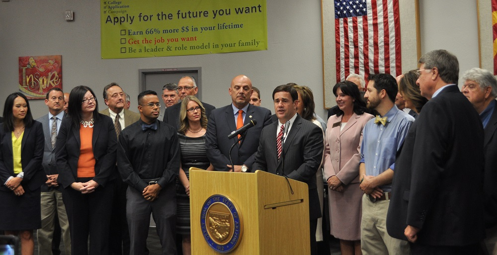 Arizona Gov. Doug Ducey Presents His Plan To Increase K-12 Public Education Funding And Settle The Inflation Funding Lawsuit At Central High School's Library In Phoenix On June 4, 2015 Surrounded By Arizona Education Advocates, State Legislators And School Superintendents. Photo By Lisa Irish/AZEdNews