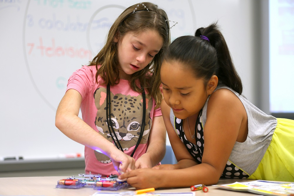 Melody Bishop And Joanna Chee Work On A Circuit Board During Summer Thunder, A Higley Unified School District Title I Camp Program. During The Four-week Program, Students Receive Academic Support In Math And Reading. Lessons Are Integrated Into A Science, Technology, Engineering And Math Lab.