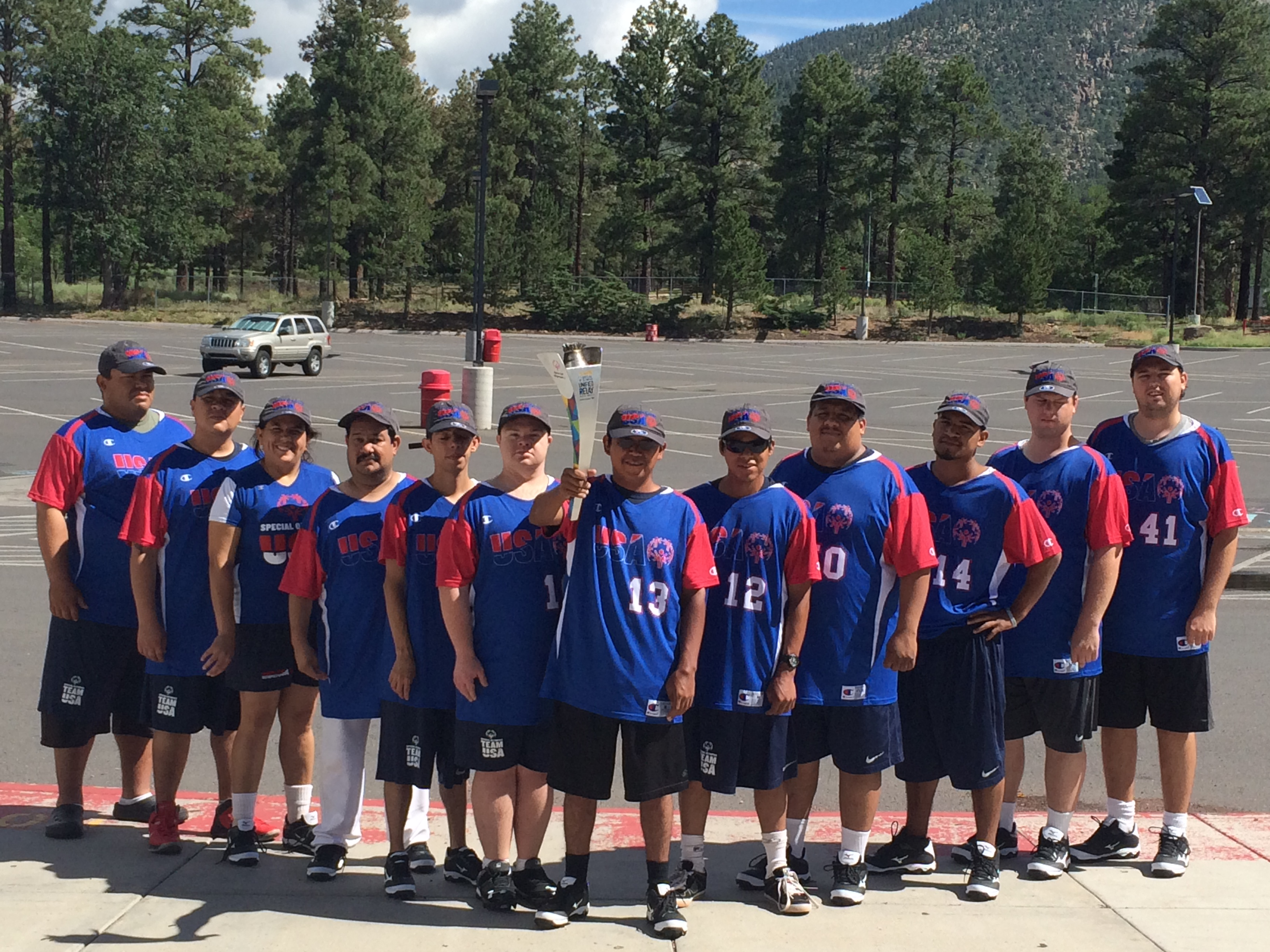 Phoenix Union employee coaches at Special Olympics Summer Games USA-uniform-with-Torch