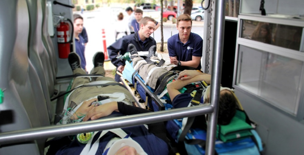 Students In The Emergency Medical Technician Program At Pima County Joint Technical Education District Practice Loading Patients Into An Ambulance After Stabilizing Their Injuries. Photo Courtesy Of Pima County JTED