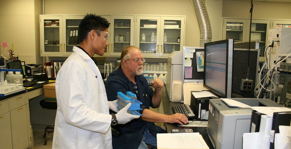 Salt River Project Scientist Cal Bonefield, Right, Shows Teachers In Industry Intern Ricardo Trevizo, Left, How Water Is Tested At The SRP Environmental Lab. Photo Courtesy Salt River Project