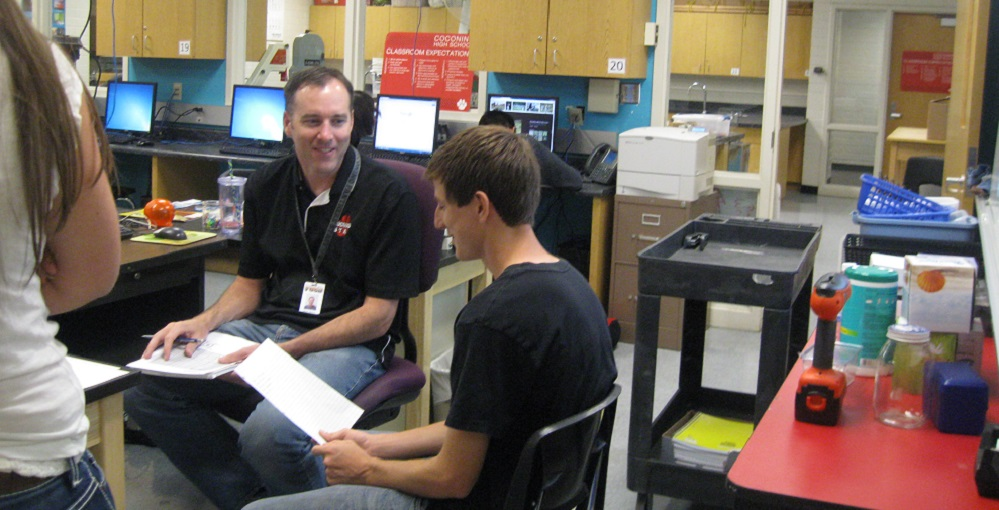 Coconino High School's Dave Tessmer Works With Students In His Engineering Classes. Photo Courtesy Flagstaff Unified School District