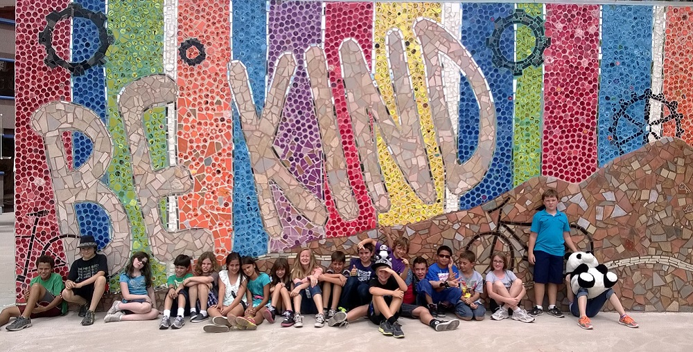 Satori Charter School Students In Front Of The Be Kind Mural At Their School In Tucson. Photo Courtesy Of Ben's Bells Project
