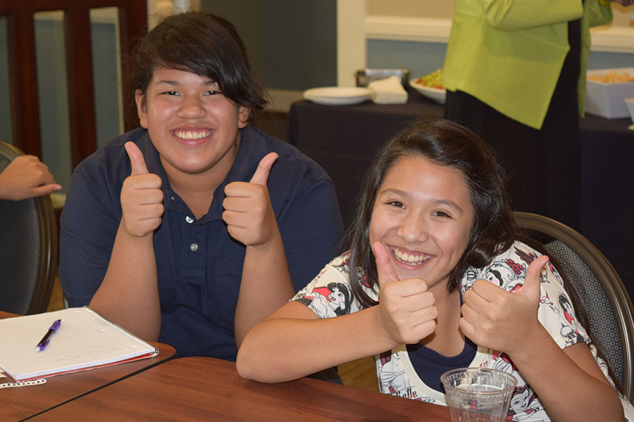 Empowering excellence, success through student leadership 8thGradeStudentsThumbsUp