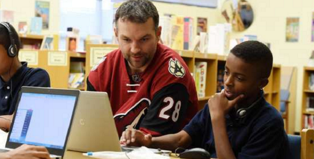 John Scott And Local Students Review NHLPA's Future Goals Which Teaches STEM Principles Through Hockey.Photos Courtesy Arizona Coyotes And EverFi
