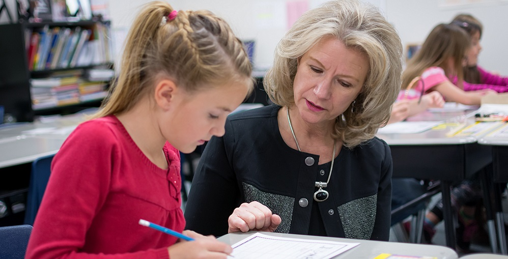 Dr. Gail Pletnick, Superintendent Of Dysart Unified School District, Working With A Student. Photo Courtesy Dysart Unified School District