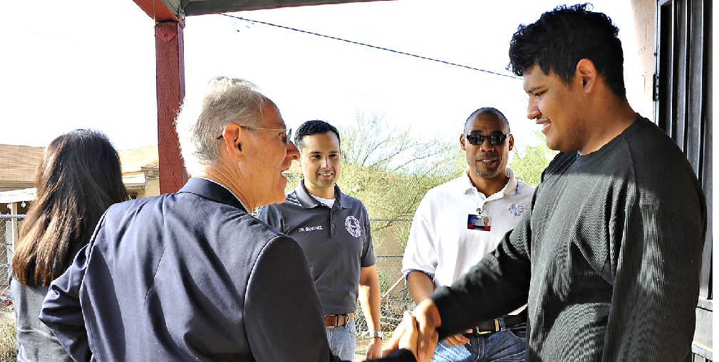 Tucson Mayor Jonathan Rothschild, Left, And Tucson Unified Superintendent H.T. Sanchez Talk With A Student At His Home During Their Steps To Success Walk That Brings Students Back To School. Photo Courtesy Tucson Unified School District