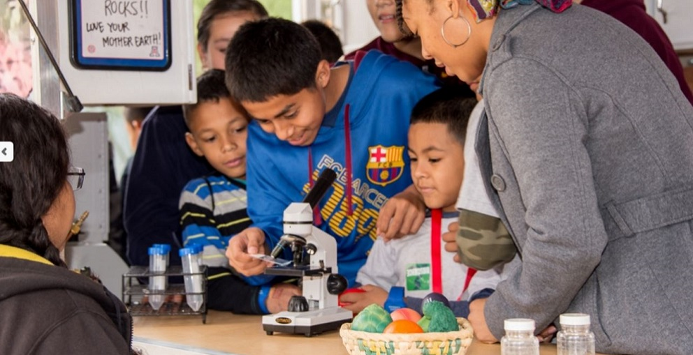 Students At The Connect2STEM Event Using A Microscope. Photo Courtesy Cox Communications