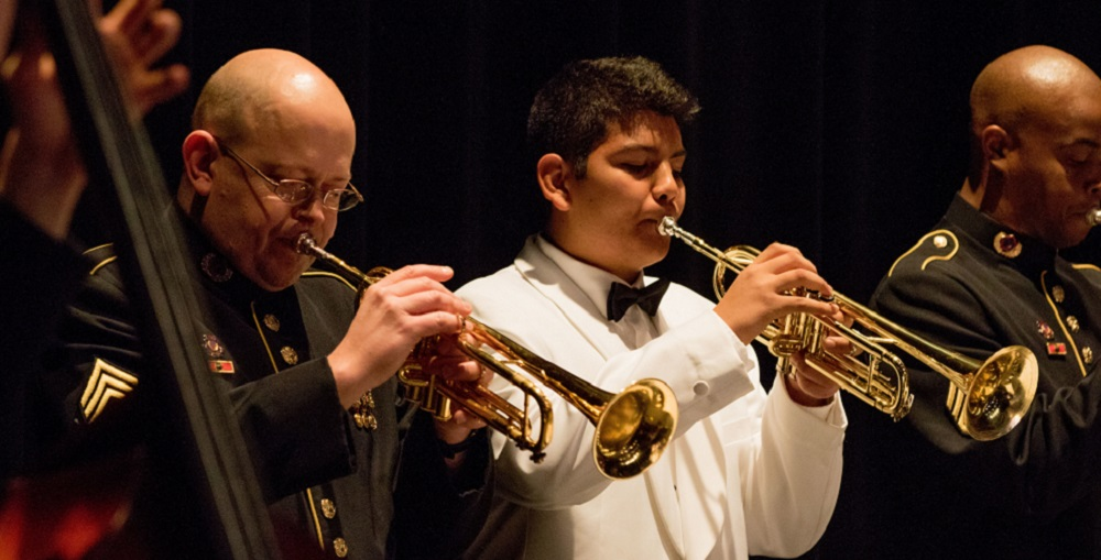 Higley High School Student, David Alvarez, Plays A Perspectives Selection On His Trumpet With The Jazz Ambassadors As Part Of Their Educational Outreach Program. The Jazz Ambassadors Concert At The Higley Center For The Performing Arts March 5, In Gilbert, Ariz. The Jazz Ambassadors Is The U.S. Army's Official Touring Big Band And Are Currently Traveling The Western U.S. On Their Spring Concert Series. (U.S. Army Photo By Sgt. 1st Class Joshua Johnson)