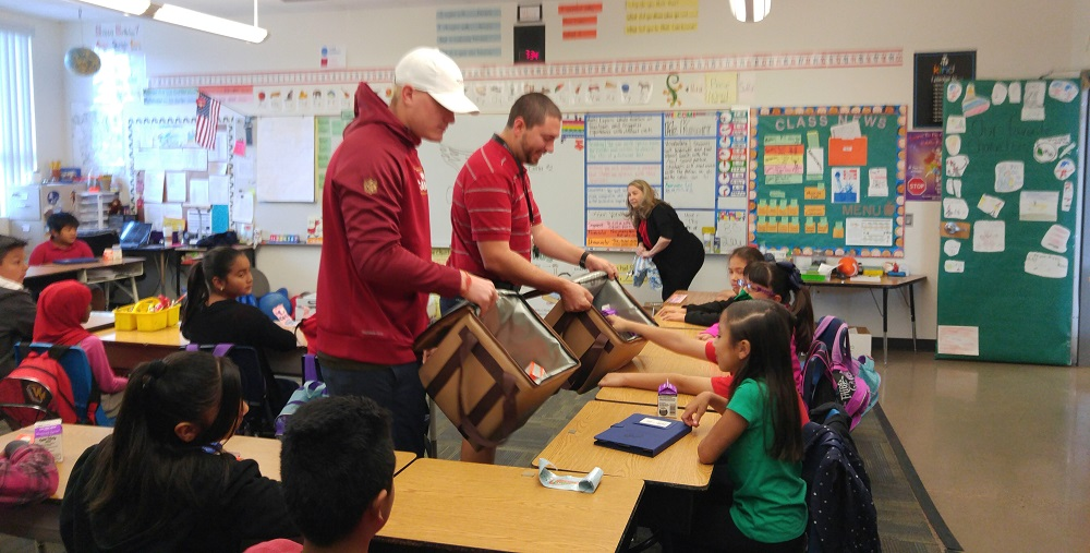Arizona Cardinals Drew Butler And Teacher Tim Knorr Serve Breakfast To Students In Knorr's Classroom At Papago Elementary School. Photo Courtesy Creighton School District