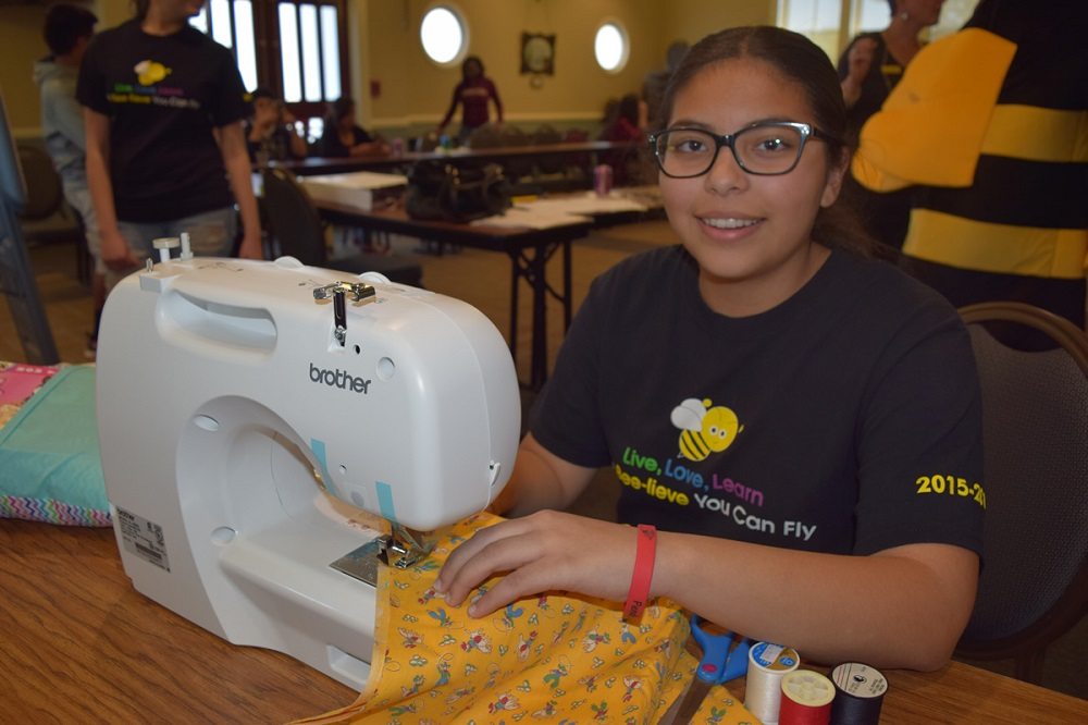 Pendergast 8th-graders, volunteers make pillows stuffed with love, literacy PendergastStudentSewing