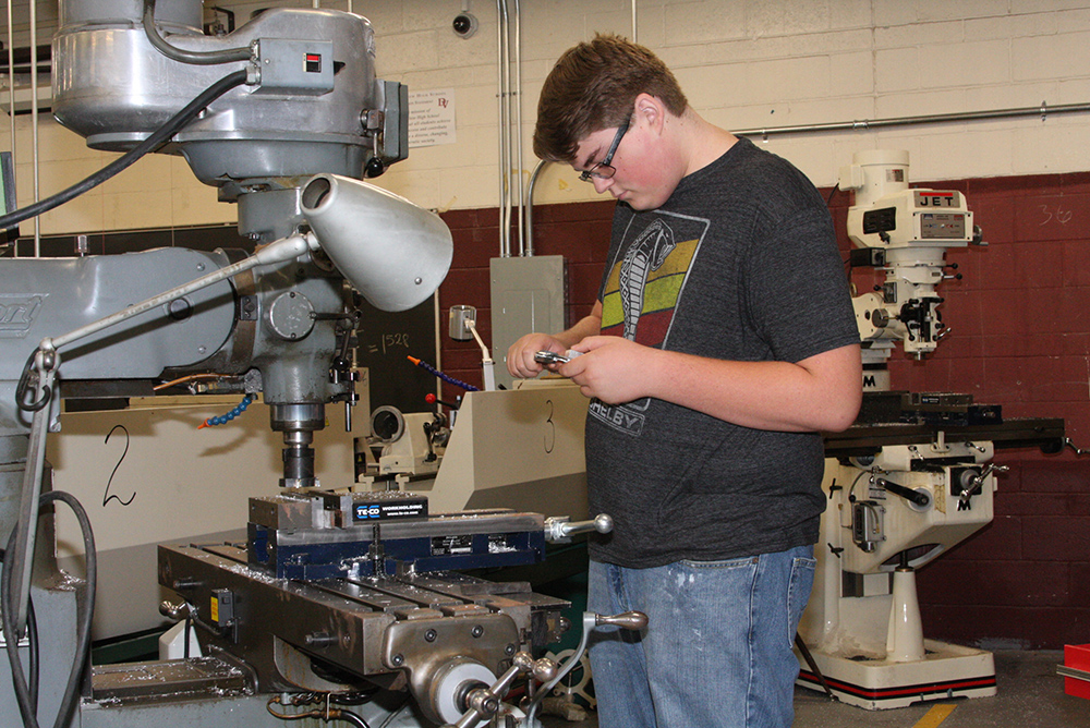 Precision manufacturing opens students' career, college pathways AStudentMeasuringAPart
