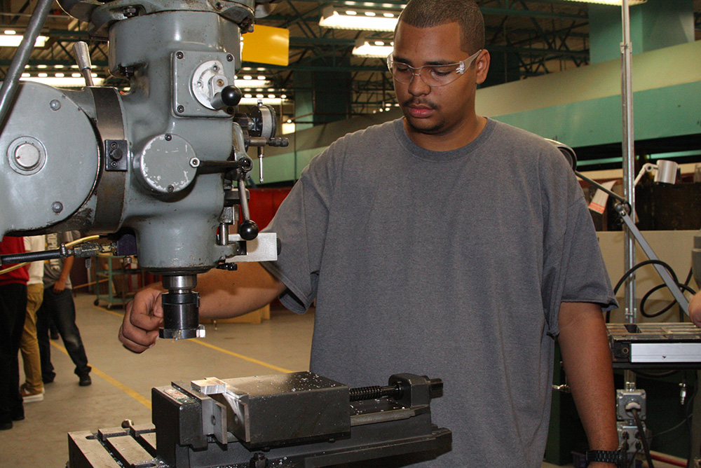 Precision manufacturing opens students' career, college pathways Student-working-with-machinery