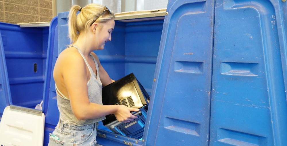 Business Freshman Meg Myers Places A Microwave Into A Donation Bin As Part Of Ditch The Dumpster. Each Year, Students In ASU Residence Halls Donate Or Recycle Unwanted Items Instead Of Throwing Them Away To Help Benefit Local Organizations And Families In Need. Photo Courtesy Arizona State University