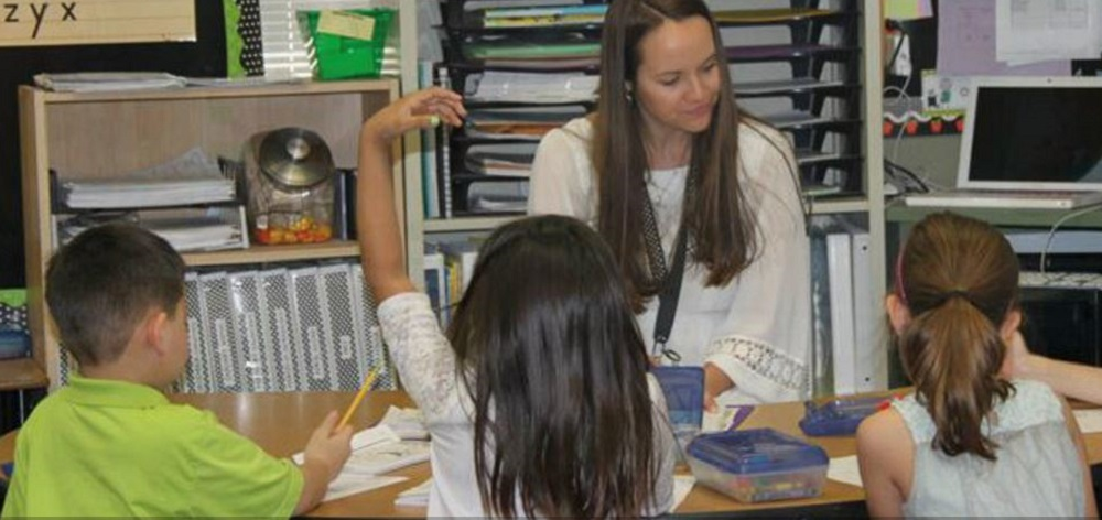 A Gilbert Public Schools Teacher Works With Her Students. Photo Courtesy Of Gilbert Public Schools
