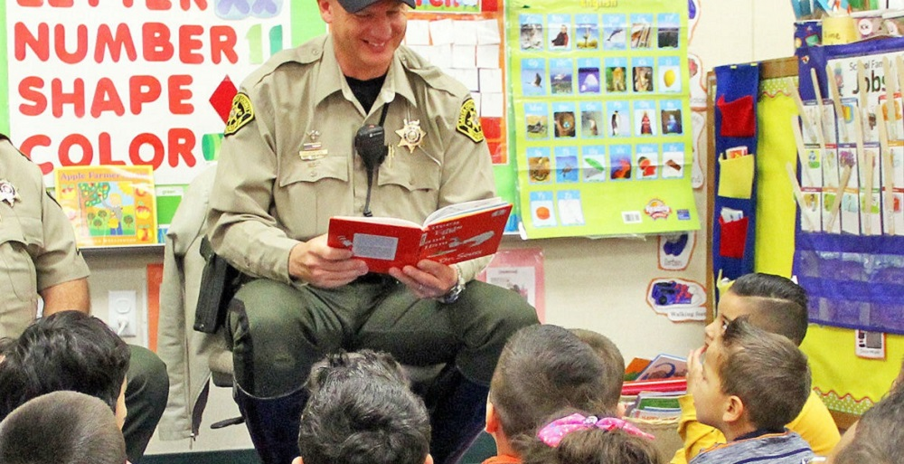 "School Resource Officer Joseph Bunting Treats Students At Calabasas School To A Reading Of ""Green Eggs And Ham"" In February. Photo Courtesy Carol Cullen/Santa Cruz Valley Unified School District"