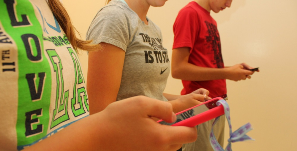 The Debate Over Cell Phones In Schools Continue. Smartphones In K-12 Brings Controversy – Disruptive Or Necessary For Learning And Safety? Photo By Intel Free Press