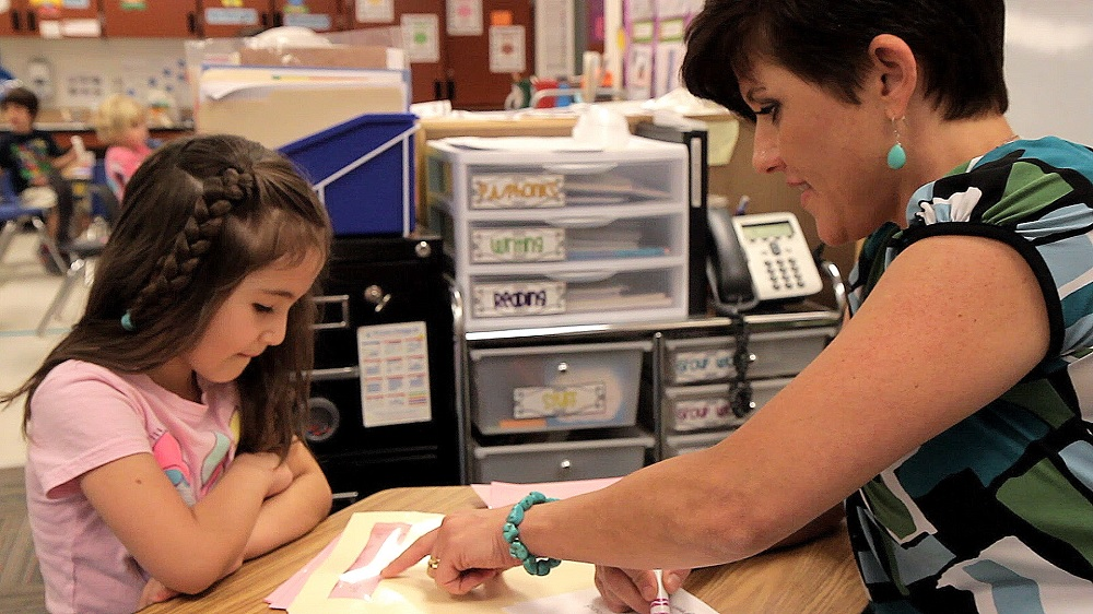 A Teacher Works With A Student. Photo Courtesy Of Paradise Valley School District.