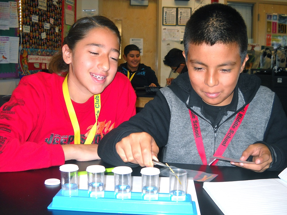 Coatimundi Middle School Students Andrea Robles And Abraham Carillo Test Solutions. Photo Courtesy Of Mary Beach/Coatimundi Middle School