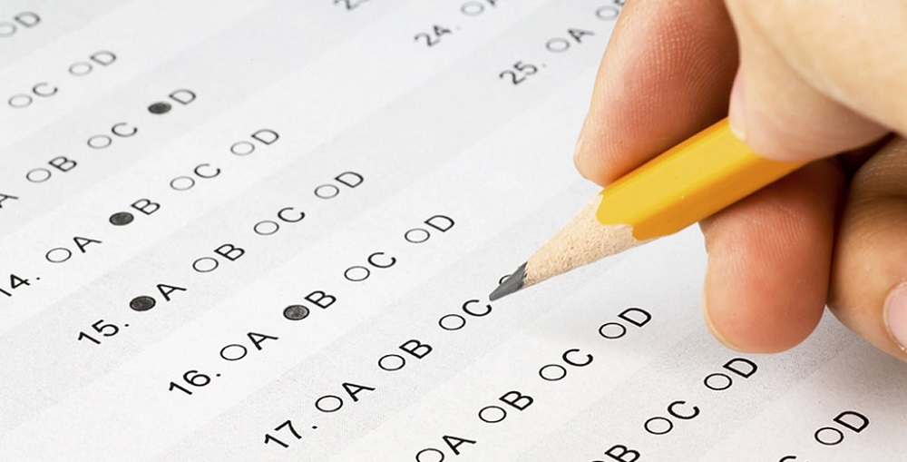Hand Completing A Multiple Choice Exam.