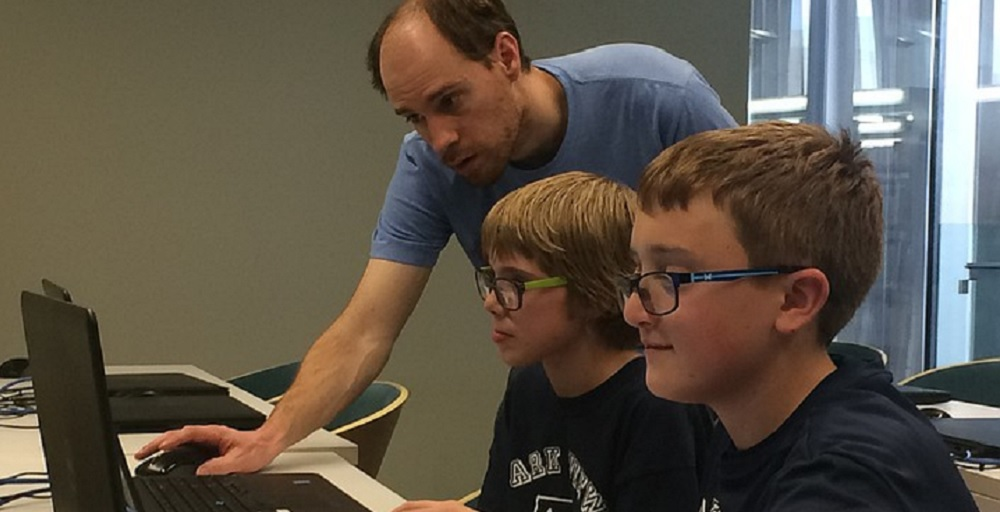 Jeff Howick Helps Two Kid Code Club Participants With Their Programs. Photo Courtesy Jason Wheeler/Prescott Valley Tribune