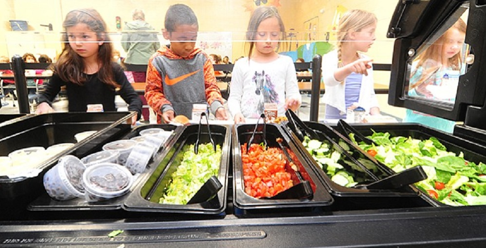 First Grade Students At Coyote Springs Elementary School Get Their Hot Lunch In The School's Cafeteria On Tuesday, May 9 In Prescott Valley. Photo Courtesy Les Stukenberg/The Daily Courier