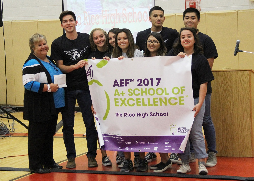 A+ Banner Held By RRHS Ambassadors Who Escorted AEF Visiting Team Around Campus During Their Review. From Left: Principal Vroegh, Sebastian Valencia, Alexandra Schadler, Delanie Rendon, Baely Ahumada, Karime Reyes, Jasmine Aguilar, Alex Arizpe (back), Mathew Tran (back). Photo Courtesy Carol Cullen/Santa Cruz Valley Unified School District No. 35