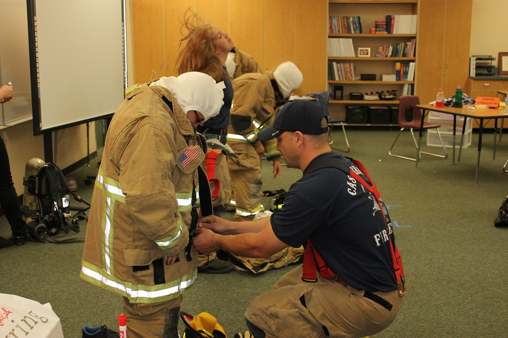 Schools partner with community to maintain student activities Casa-Grane-Firefighter-Career-camp