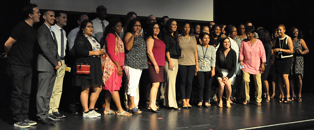 The people partnering to make a change with the Demand2Learn initiative take the stage for a group photo after the launch event on Aug. 9, 2017 in Phoenix at the Phoenix Center for the Arts. Photo by Lisa Irish/AZEdNews