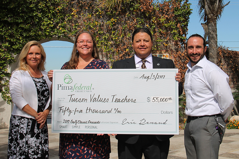 Senior Leadership From Pima Federal Credit Union Presented A Check To Katie Rogerson, Chief Operating Officer Of Tucson Values Teachers, Worth $55,000 For Use In TVT's Tucson Supplies Teachers — The Annual Supply Drive For Local Educators.