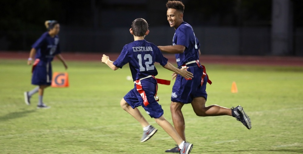 Sebastian Ekstrand, Center, And Cooper Jones, Right, Play Together On The Flag Football Team At Higley High School As Part Of Their Unified Sports Program. Photo Courtesy Higley Unified School District.