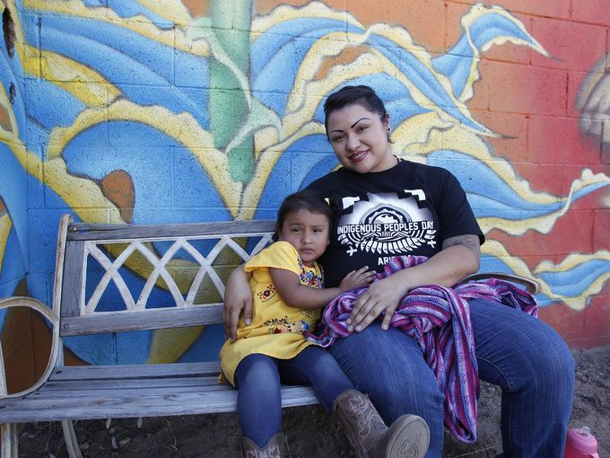 Chef Maria Parra Cano Takes A Break From Cooking And Holds Her 3-year-old Daughter Yalehua. Parra Cano Was Preparing Beans, Squash, Deer And Bison For The Indigenous Peoples Day Celebration In Phoenix On Oct. 10, 2016. (Photo By Laura Gomez/The Arizona Republic) Link To Http://www.azcentral.com/story/news/local/phoenix/2016/10/10/phoenix-celebrates-indigenous-peoples-day/91880328/