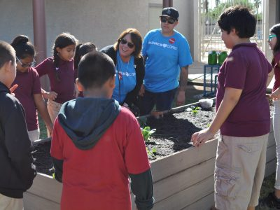 School garden helps lower students' stress, behavioral issues DebKuczoraAndStudentsInGarden6-1-400x300
