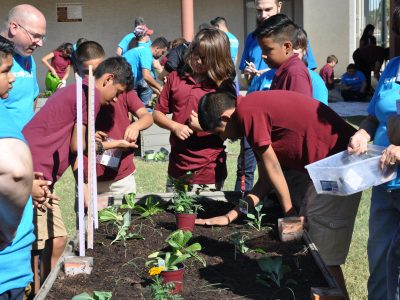 School garden helps lower students' stress, behavioral issues DustinAndStudentsCloseUpInGarden-400x300