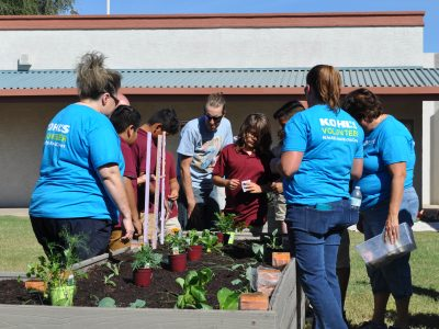 Slideshow: Students plant new garden courtesy of Kohl's Mindful Me program DustinAndStudentsInGarden1-400x300