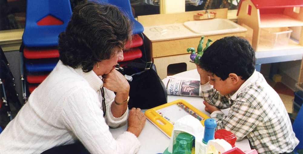 "Teacher Appreciation"" Featured Photo. Place Unknown. A Kindergarten Or Special Education Teacher Instructing A Student. Source: U.S. Census Bureau Facts For Feature Photos"