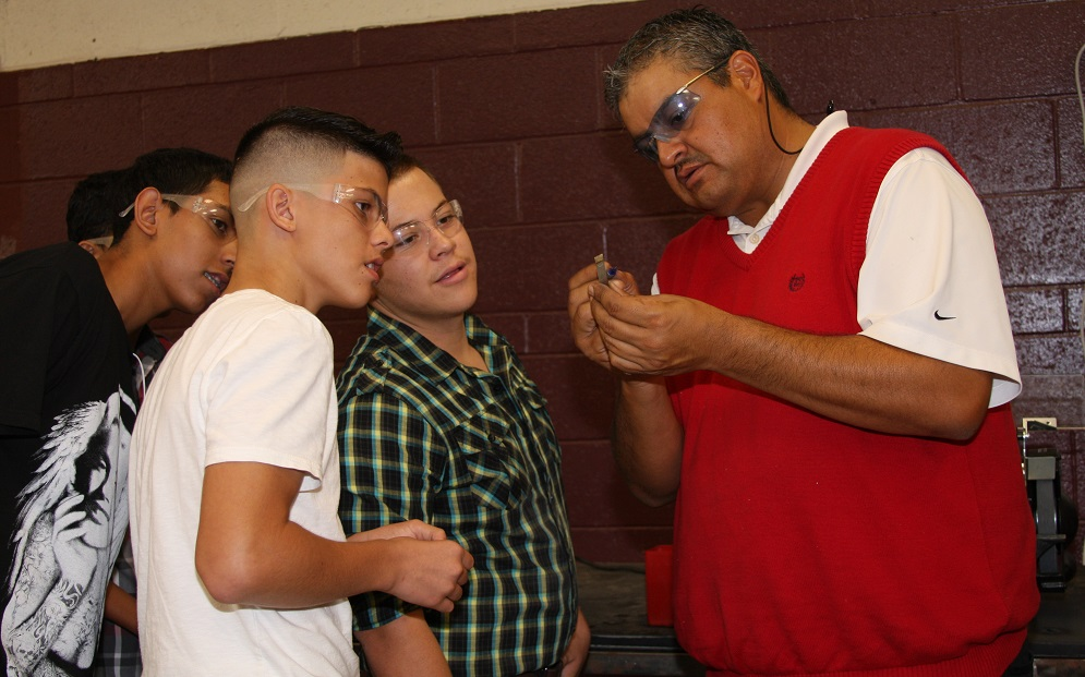Cesar Gutierrez, Who Teaches Drafting, Design And Precision Manufacturing, Works With Students On A Part. Photos Courtesy Of ISTEM Precision Manufacturing Program At Desert View High School In The Sunnyside Unified School District