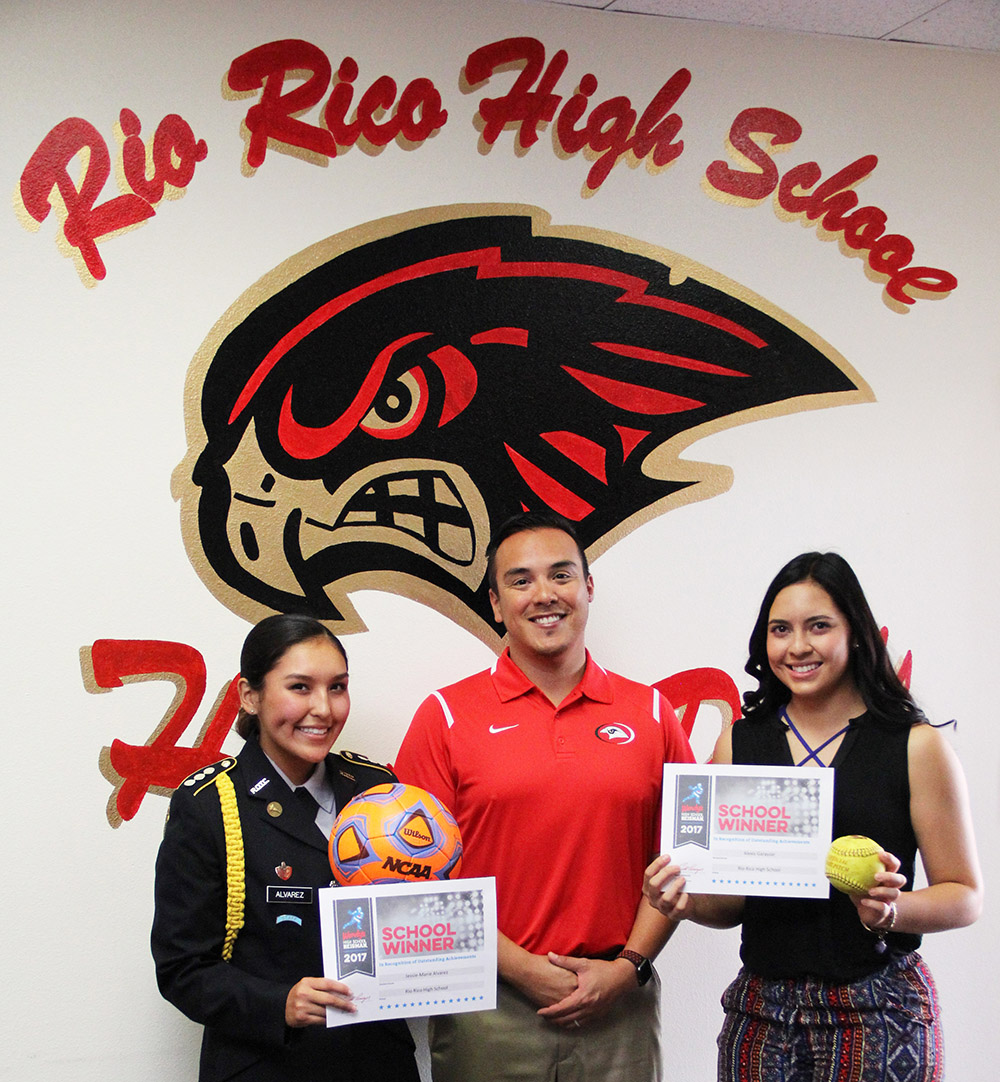 At A Recent Governing Board Meeting, Rio Rico High School Seniors, Jessy-Marie Alvarez And Alexis Garayzar, Were Each Presented With The Wendy's High School Heisman Award By RRHS JROTC Instructor, Col. Ronnie St. Clair. Photo Courtesy Rio Rico High School