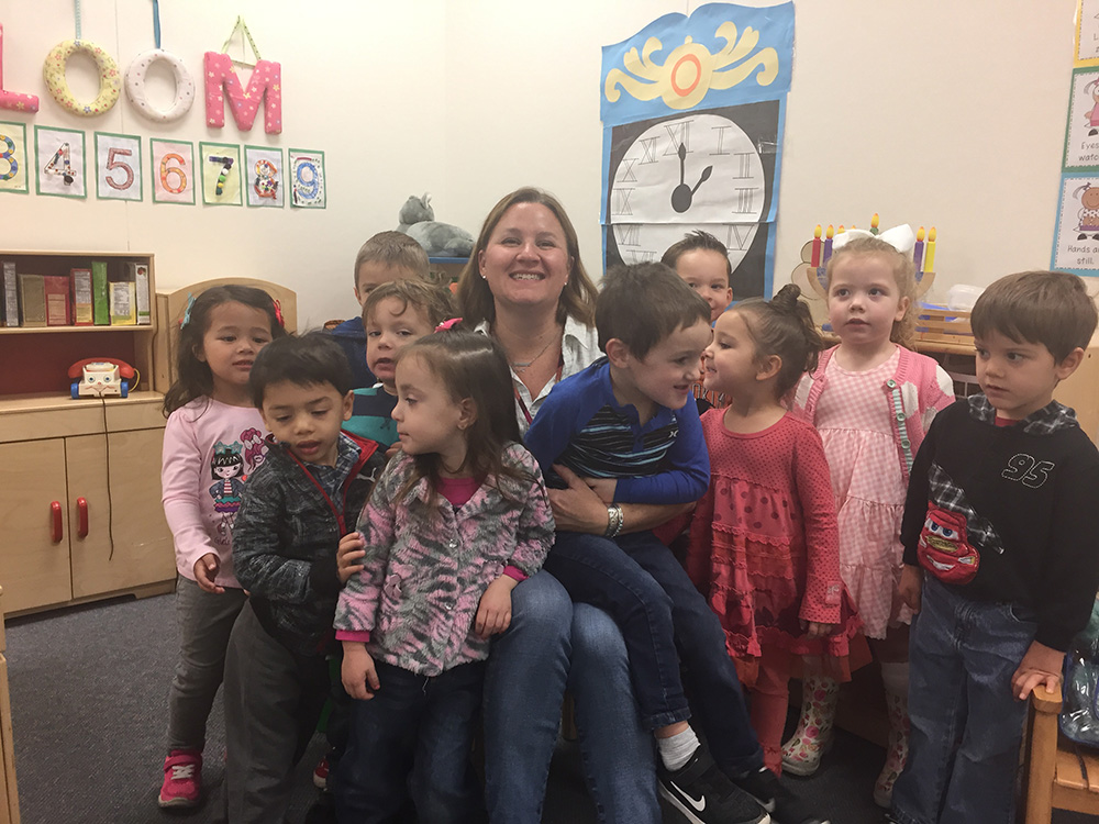 Maureen Love, A Teacher At The Developmental Preschool, Will Use The 2017 Fiesta Bowl Charities Wishes For Teachers Grant To Buy Books For Her Classroom. Photo Courtesy Of Cave Creek Unified School District
