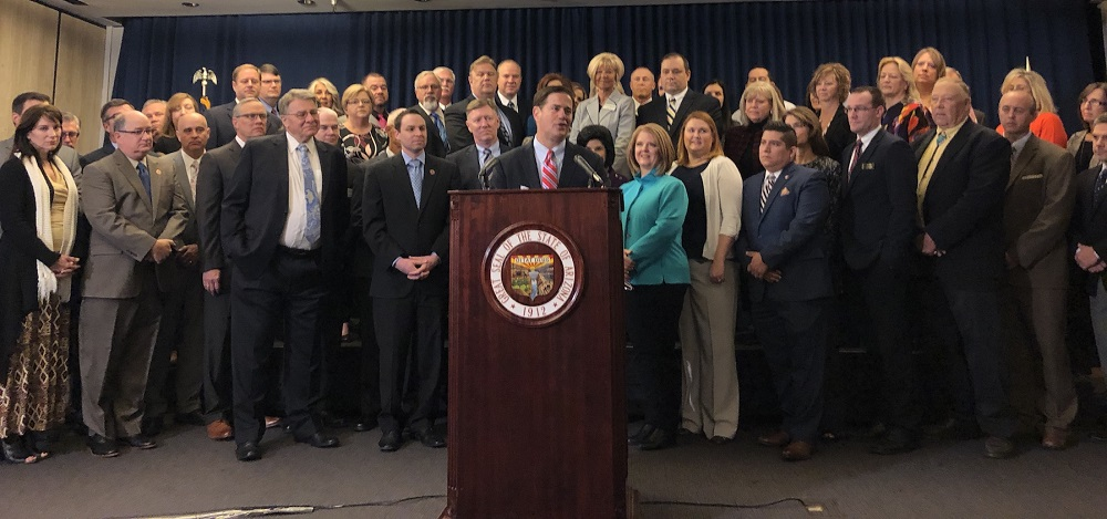 Gov. Doug Ducey Announces His Budget Proposal To Restore Additional Assistance To Public Schools Over The Next Three Years At The Arizona State Capitol On Jan. 9, 2018 Surrounded By Legislators, Superintendents, School Business Officials, Business Leaders And Education Advocates. Photo Courtesy The Office Of The Governor.