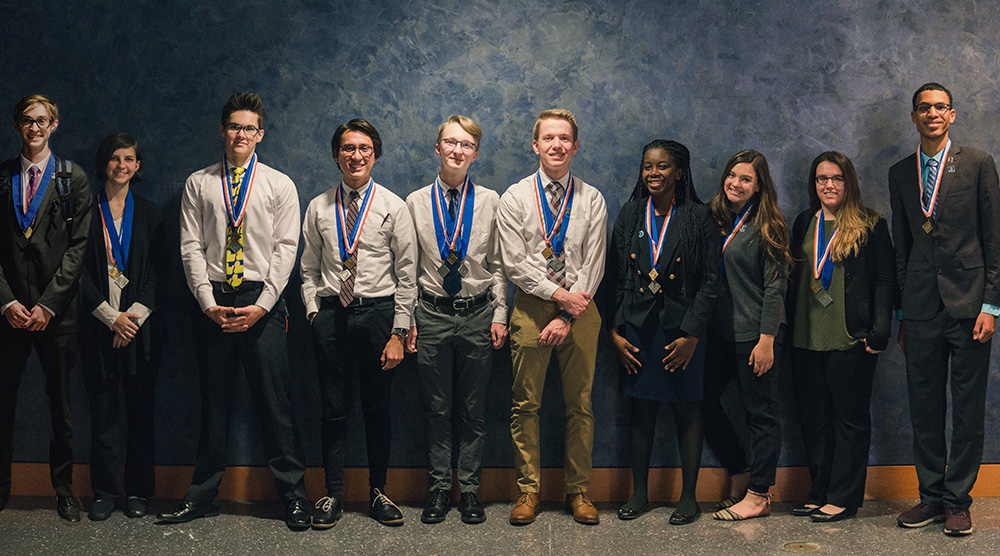 These Williams Field High School Black Hawks Placed In The Top 3 Of The Events They Participated In At The DECA District Competition Held Jan. 16. They Are, Left To Right, Ben Udall, Cooper Jensen, Jaxson Billie, Alex Rusaw, Heber Ciminski, Ruth Nyagaka, Kate Koneiczny, Amanda Gomez, And Fernando Robles. Photo Courtesy Of Higley Unified School District