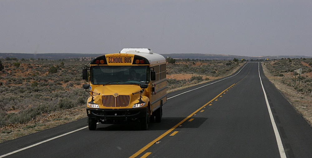 A School Bus In Nowhere, Arizona Providing Transportation For Students. Photo Courtesy Of OliBac Via Flickr. Https://www.flickr.com/photos/olibac/4502046733
