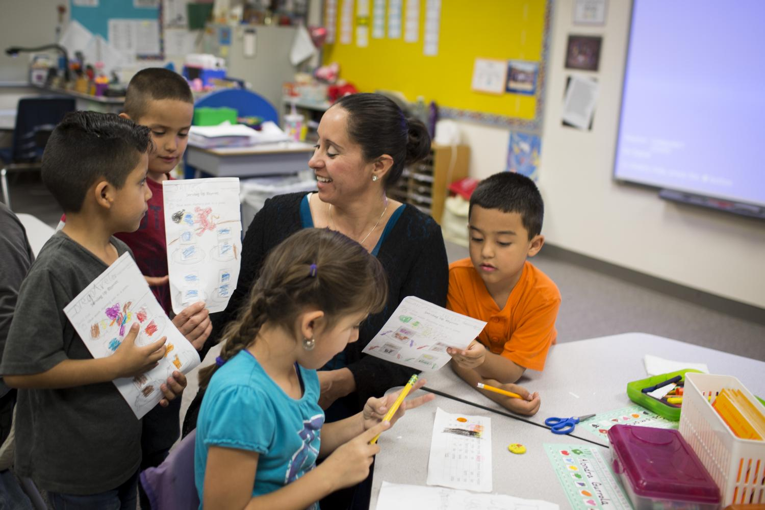 Rainbow Valley Elementary School English Language Acquisition Teacher Bedelicia Reyna Is Approached By Several Students Hoping To Show Her Their Work In Class. Photo Courtesy Caitlin O'Hara. Story Link: Https://kjzz.org/content/469898/arizonas-ell-classrooms-struggle-teacher-shortages-low-graduation-rates