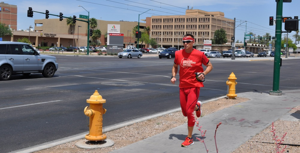 Landon Benson, A Sonoran Foothills Physical Education Teacher, Runs To The Capitol On Thursday, April 26 As Part Of The #RedForEd March And Rally. Photo By Mary Irish/AZEdNews